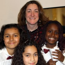 Debra Heffernan at the white House with members of Maple Lane Elementary School who were invited to perform holiday songs