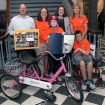 Tess Aeschleman from the 6th district receives an adaptive bicycle from Preston's March for Energy.